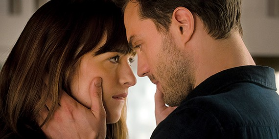Dakota Johnson (left) and Jamie Dornan interact with expensive products in Fifty Shades Freed.