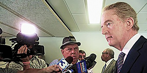 Election Commission's Robert Meyers speaks to the press.
