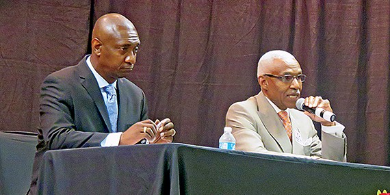 Mike Williams, looking deadpan as usual, bides his time, here listening to Mayor A C Wharton at last week's mayoral forum at Mississippi Boulevard Christian Church. The cash-poor Williams is largely dependent on debates and social media to get his message out.
