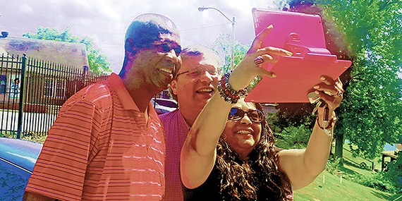 Chism picnic attendee Gale Jones Carson takes a selfie with Mayors Herenton and Strickland