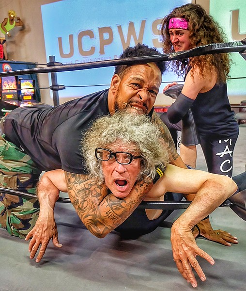 This probably is what it would look like if I ever got in the ring with Kontar and Andy Mack at a UCPWS live wrestling event at the Rec Room. I'll stick to standing outside the ring at the twice-a-month events, which are a blast. - JON W. SPARKS