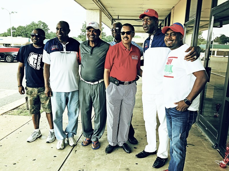 Reginald Tate (2nd from right) with friends atSaturday  headquarters opening.  Flanking are County Commissioner Willie Brooks and Young Democrat Alvin Crook, with former City Clerk Thomas Long nearby. - JB