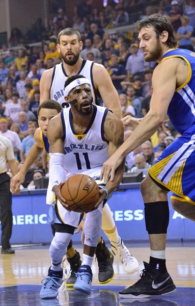 Mike Conley, shown here beating the Warriors with a broken face - LARRY KUZNIEWSKI