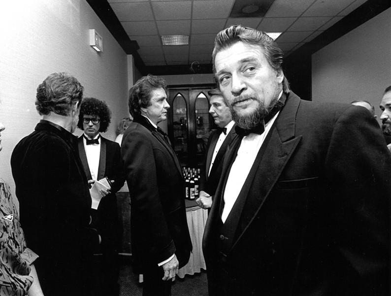 "A darker-haired Michael Donahue ""backstage"" at The Peabody in 1986 with Johnny Cash, Kris Kristofferson, Waylon Jennings and Mayor Bill Morris. - MICHAEL MCMULLAN"