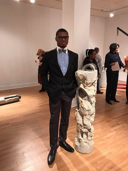 LEWIS WITH A PREVIOUS SCULPTURE HE CREATED