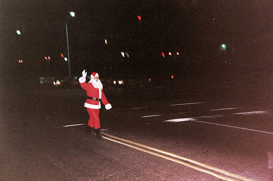Andy Hyrka dressed as Santa. Here he is  on Poplar at Avalon in front of my apartment building.
