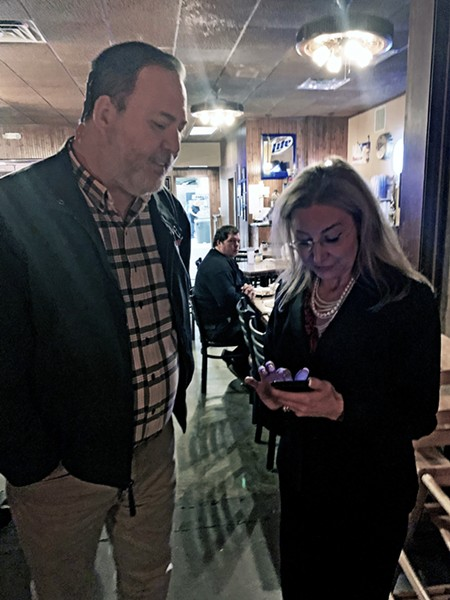 THE AGONY OF DEFEAT: Lonnie Treadaway, who recently lost his bid to join the Memphis City Council, consoles Heidi Shafer as she confronts the numbers at her election-night party at Exline's Pizza on Stage Road. Shafer was one of three Shelby Countians to lag behind GOP nominee Paul Rose of Tipton County in voting for the Republican nomination for state Senate District 32. - JB