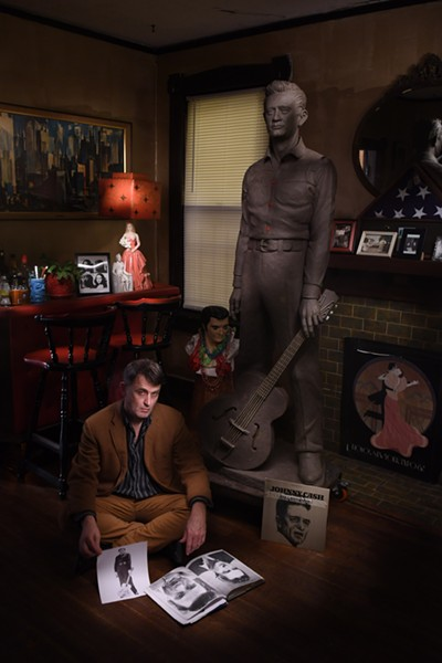Mike McCarthy with his clay sculpture of Johnny Cash, before casting. - DAN BALL
