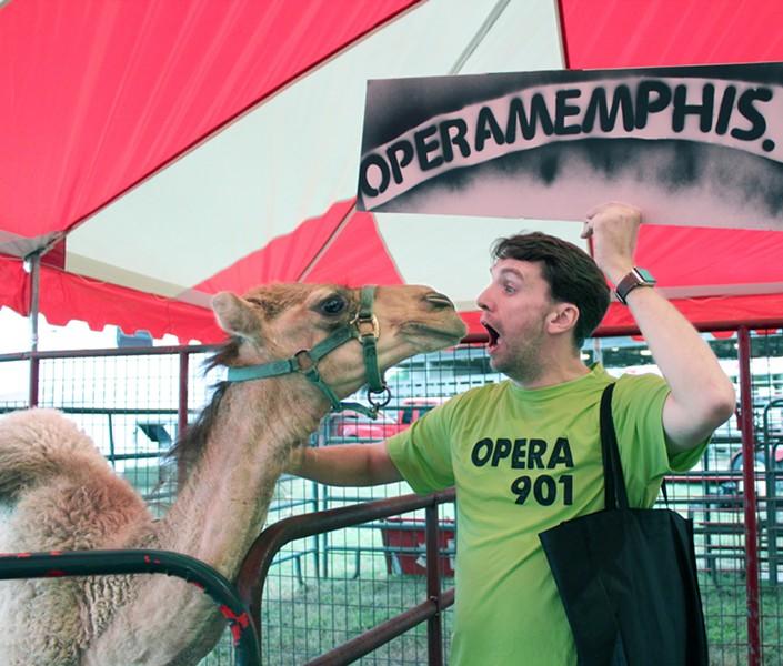Jordan Wells lights up a camel at a past 30 Days of Opera event at the West Tennessee State Fair. - JILLIAN BARRON