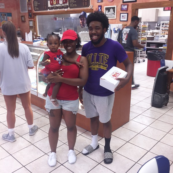 """Allician Holley, Ava Cox, and Clentis """"CJ"""" Jennings at Gibson's Donuts. - MICHAEL DONAHUE"""