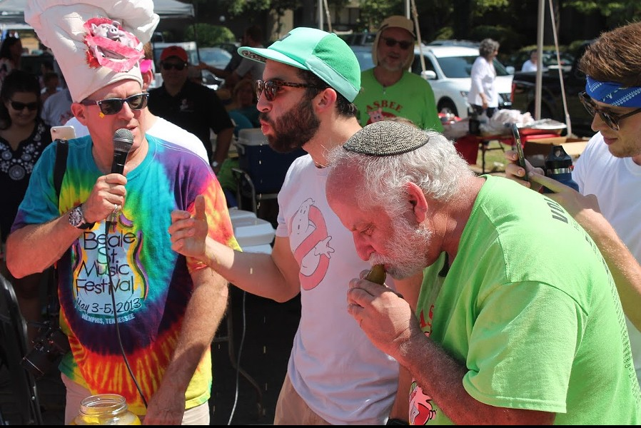 Sam Fargotstein, center, won the adult dill pickle eating contest at the ASBEE (Anshei Sphard-Beth El Emeth) Kosher BBQ Competition and Festival. - SARAH BETH COHEN-WILCOX