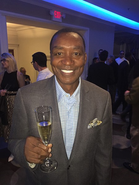 Isiah Thomas and his Cheurlin Champagne at the chef's party for Memphis Food & Wine Festival. - MICHAEL DONAHUE