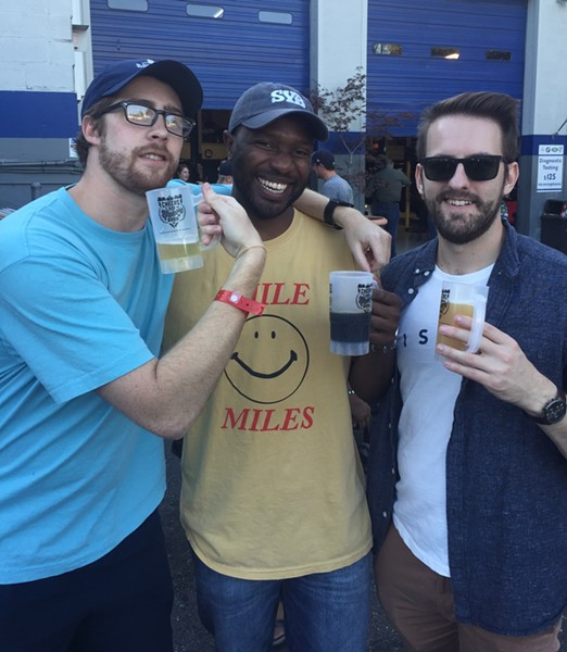Geoff Davis, Dex McCune, and Drew Fleming celebrated at the 10th annual Cooper-Young Beerfest, which was held October 19th at  Midtown Autowerks. More than 40 breweries were represented. Proceeds support the Cooper-Young Community Association. - MICHAEL DONAHUE