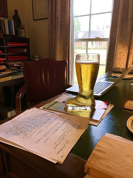 Working from home with a tall - work boot full of local brew - RICHARD MURFF