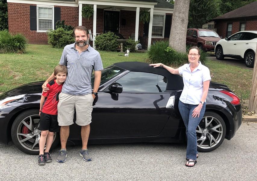Jake Seidman, Jeffrey Seidman, and Debbie Dodson with the Nissan 370Z.