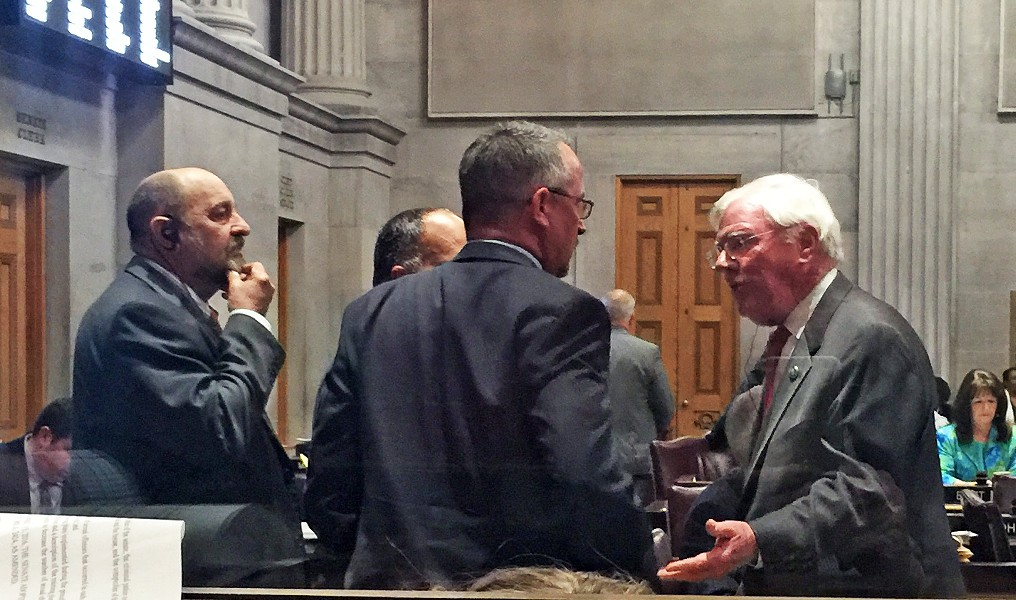 Left hanging Wednesday night in the Tennessee House of Representatives was a measure to phase out the state's Hall Income Tax on inrerest and dividends. The Senate version of the bill would cut the tax from 6 percent to 5 percent in the coming year and continue reductions at 1 percent a year until the tax's elimination in 2021. - Conservative militants in the House like Rep. Billy  Spivey (R-Lewisburg) demanded a quicker trigger, however, one tied to increases in state revenue growth. Here Spivey (center) is being reamed out  for the obstruction by a furious Rep. Charles Sargent (right), the Franklin Republican who chairs  the House Finance, Ways and Means committee, while Rep. Ron Lollar (R-Bartlett), another foe of the proposed change, observes. - At stake, for Lollar and others, was the pending loss of shared revenues for cities and counties provided by Hall Tax revenue. - The imbroglio was left  to be resolved, along with other pending matters, in a meeting of the Finance Committee Thursday morning. - JB