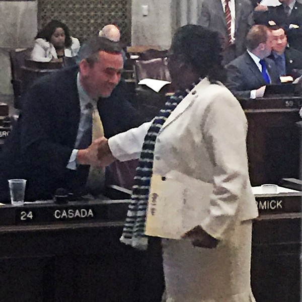Sweet reason prevailed in at least one other matter, however, as is indicated by this handshake of reconciliation  between Rep. Glen Casada (R-Franklin), the GOP caucus chair, left, and Rep. Karen Camper (D-Memphis), after Casada decided to withdraw a crippling amendment, one with a stout fiscal note , from a bill by Camper. Her bill  would  create a task force to study the creation of a department of juvenile justice. - Casada's change of mind , which allowed easy passage of the final measure, occurred some two hours after he had added the amendment in a debate that had obvious partisan overtones. - JB