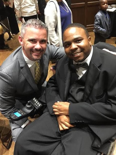 University of Memphis football Coach Mike Norvell and Mario Reed