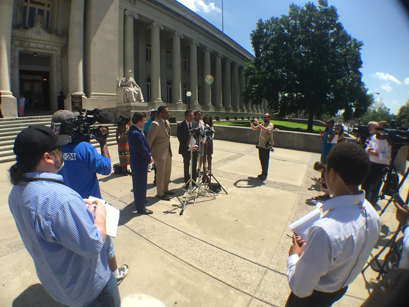 Attorneys for the family of Darrius Stewart announce their lawsuit against the city of Memphis at the Shelby County Courthouse Wednesday. - TOBY SELLS