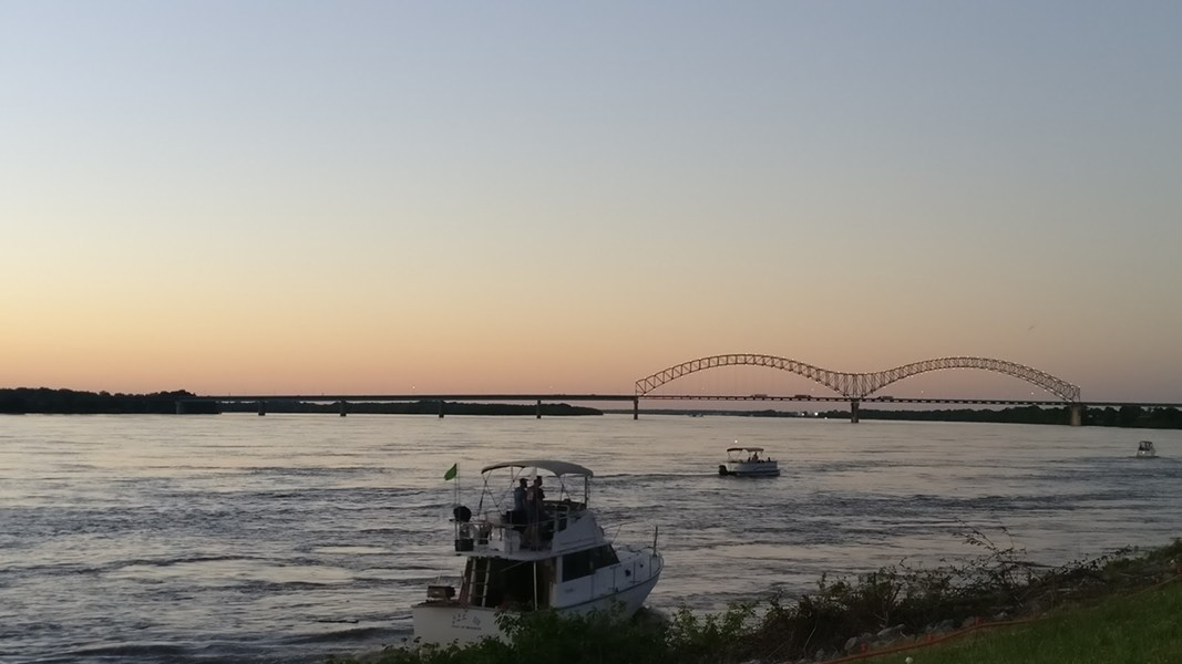 Memphis Police Department spent much of Sunday shooing boats away from the festival grounds. - E.J. FRIEDMAN