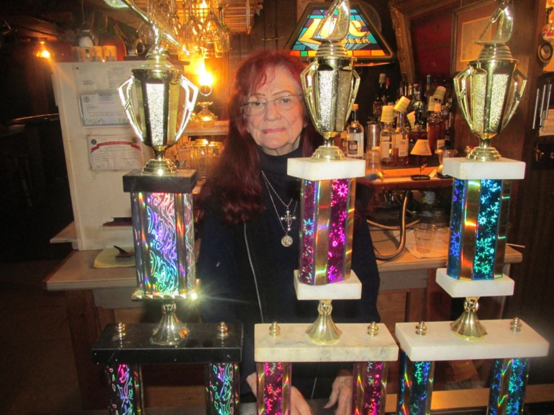 Ruthell Reynolds with some trophies won for dart-related activities at The Windjammer. - MICHAEL DONAHUE