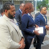 Shelby County Democratic chairman Corey Strong (right) and other Democrats announcing lawsuit at Friday press conference