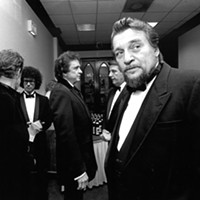 """A darker-haired Michael Donahue """"backstage"""" at The Peabody in 1986 with Johnny Cash, Kris Kristofferson, Waylon Jennings and Mayor Bill Morris."""