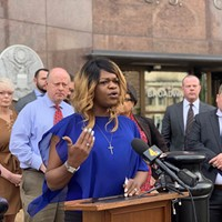Kayla Gore, of Memphis, speaks during a news conference Tuesday outside the federal courthouse in Nashville.
