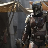 Under that fashionable armor is Pedro Pascal as The Mandalorian bounty hunter.