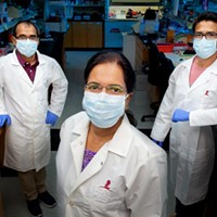 Thirumala-Devi Kanneganti, vice chair of St. Jude Immunology (center), Bhesh Raj Sharma, (left), and Rajendra Karki, (right), in Kanneganti's lab.