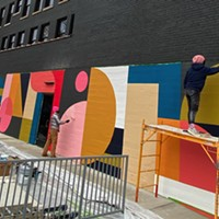 Erin Miller Wray working on her mural on the side of the Ambassador Hotel, which is the future home of South of Beale gastropub.