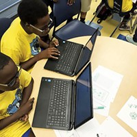 Students practice computer coding with CodeCrew.