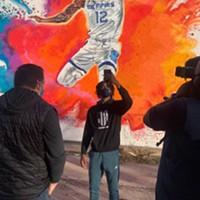 Ja Morant taking a selfie in front of his mural