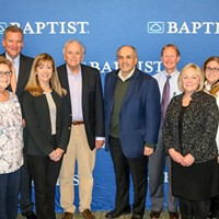 Members of the Kosten Foundation donate funds for research to Baptist Clinical Research Institute.