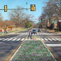 This drawing shows a re-imagined, more pedestrian friendly intersection of Poplar and Cooper.