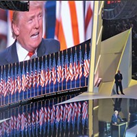 Standing before an array of flags, presidential candidate Donald Trump addresses the RNC.