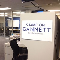 """The Guild has hung """"shame on Gannett"""" posters around the office at the newspaper's headquarters at 495 Union."""