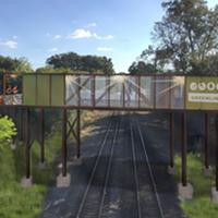 Rendering of possible bridge design over active railroad