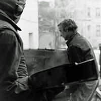 Ed Perry and Rockne Krebs unload one of their urban-scale installations