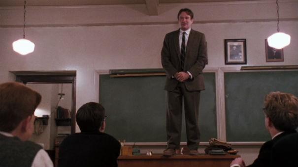 "Robin Williams in the famous desk scene from 1989's ""Dead Poets Society."" - CINEMA FANATIC"