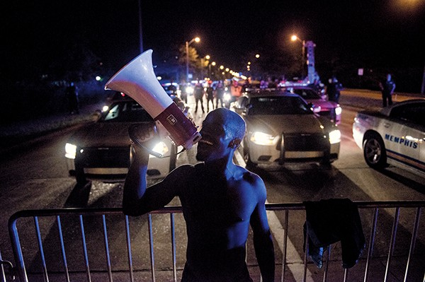 Protesters take to the street. - BRANDON DILL