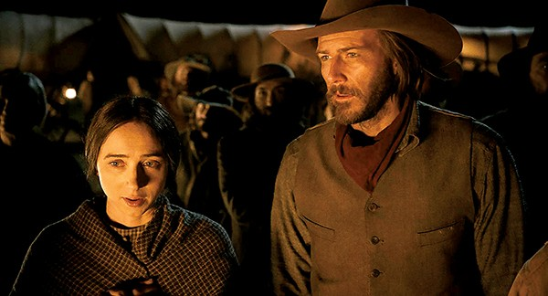 """Zoe Kazan (left) and Bill Heck star in """"The Girl Who Got Rattled"""" in the Coens' send-up of the Western genre, The Ballad of Buster Scruggs."""