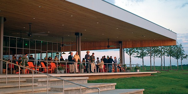 The front porch of the FedEx Event Center overlooks Hyde Lake. - JUSTIN FOX BURKS