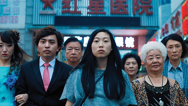 Awkwafina (center) stars in Lulu Wang's new heartfelt film The Farewell.