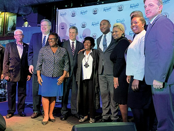 Political eminences crowded the stage last week at B.B. King's - on Beale to honor the legendary street's being officially admitted into the national historic register. - JACKSON BAKER