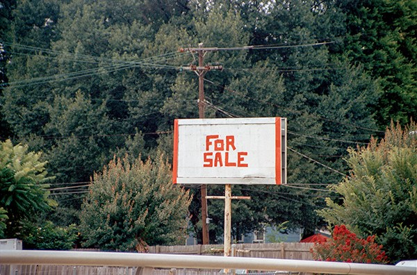 "For Sale, part of ""To Disappear Away (Places Soon to Be No More),"" shows a hand-painted billboard advertising an unknown product."