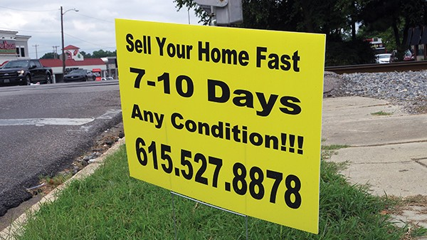 Printed and hand-made signs pop up at intersections. - JESSE DAVIS