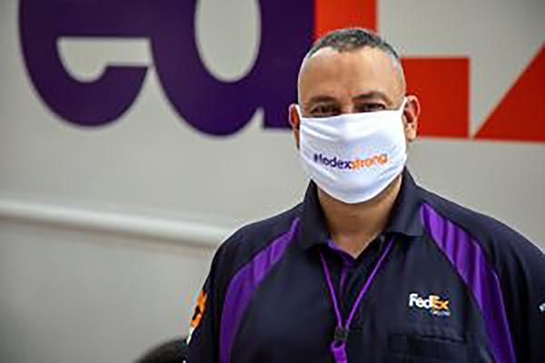 A masked FedEx employee - FEDEX CORP.