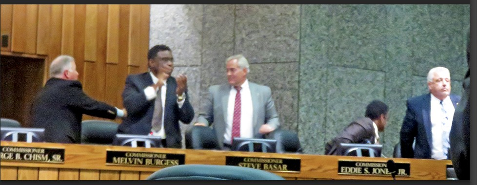 NOW YOU SEE IT, NOW YOU DON'T — in this tableau, George Chism is reaching behind an applauding Melvin Burgess to congratulate County Commission chairman-elect Steve Basar, while  Eddie Jones looks away and Terry Roland appears disappointed. All of this would be turned upside down an hour later. - JB