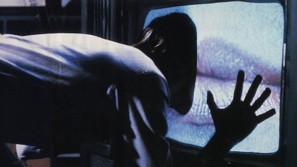 James Woods gets personal with his new device in Videodrome.